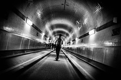 suction effect (Dan-Schneider) Tags: streetphotography schwarzweiss silhouette noir tunnel light blackandwhite bw shadow urban hamburg street