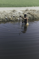 Bored guy fishing (PandaOppa) Tags: red people human farm sekinchan malaysia river ocean fujifilm moment sky selangor