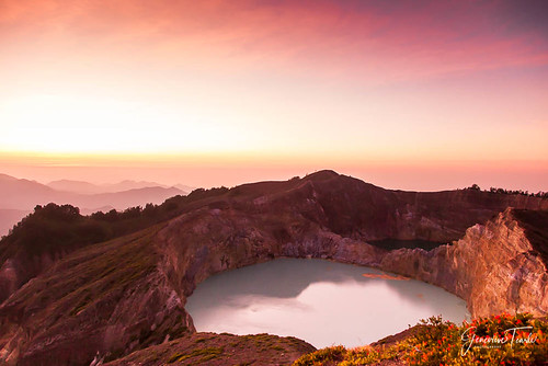 The sun rises over the crater lakes of the volcano in Kelimutu National Park, near Moni, Flores, Indonesia (August 2015)