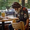 THE PROFESSOR (NC Cigany) Tags: food man beard reading restaurant book nc odd wig curious professor bojangles