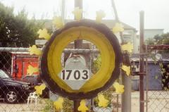 44990012 (alexdotbarber) Tags: color analog 35mm rangefinder tire f8 kodakgold100 1125 expiredfilm colorfilm colornegative petri7s 45mmf28 houstonfirstward