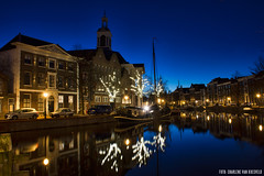 Blue Hour, Schiedam (Charlene van Koesveld) Tags: schiedam blue bluehour cold freeze freezing lights night dark longexposure morning langehaven jenevermuseum gin trees water boat holland dutch netherlands nederland southholland zuidholland city cituscape building architecture church winter autumn reflection outdoor thebluehour