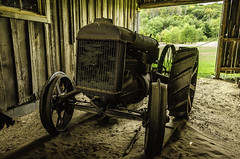 Fordson tractor laid to rest (TAC.Photography) Tags: tractor fordson wooden barn roughwood michiganfarm historic farmequipment rusty rustyequipment oldtractor