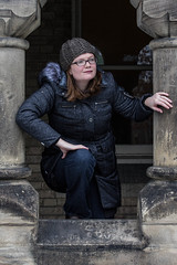 Adventures in the Big City (lacygentlywaftingcurtains) Tags: universityoftoronto universitycollege stgeorgecampus pretty oldbuilding architecture stone posts pillars toronto ontario column winter coat furhood toque woman female glasses climbing breezeway portrait