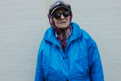 blue lady L1260249 (rafhuggins) Tags: leica old blue sun man hat lady dark glasses town hall coat style isle ramsey