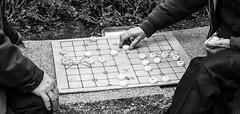 Elder Pastime (rlmccutchan) Tags: street urban blackandwhite bw game boston ma chinatown board chinese elder checkers 23mm fujix100t