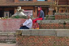 Waiting on the Afternoon (jfusion61) Tags: nepal woman man square nikon d750 kathmandu durbar bhaktapur 2470mm