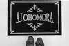 74/100 - New Doormat (AndreaDrops) Tags: 100happydays canon60d beautifullight canon1755mmf28 harrypotter doormat mat alohomora spell shoes blackandwhite