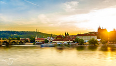 Sunset over Prague (CJ Luck) Tags: cj castle castlehill charlesbridge czech europe european evening hill national orange outdoor prague praguecastle royal sony sonya77 sunrise twilight vltavariver water yellow afterglow background boat bridge city cityscape cjluck cloud cloudy country cultural dawn eventide glow golden historic historical landmark lanscape lastlight magichour overlook overview red reflection river riverside scenery scenic scent shutter sightseeing slowshutter sun sundown sunset view viewpoint village waterfall waterscape wide