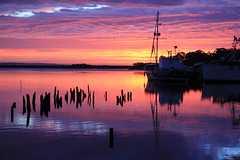 On the way to a dramatic sunset (jpotto) Tags: australia tasmania sunset harbour boats transport fishing reflection