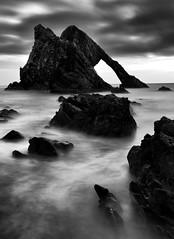 Bow Fiddle Rock (PeskyMesky) Tags: aberdeen aberdeenshire bowfiddlerock le longexposure rock sea sky flickr monochrome bw blackandwhite scotland