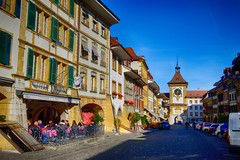 Historic Murten, Switzerland (` Toshio ') Tags: toshio murten morat switzerland europe swiss european clocktower village city street cafe restaurant sky medieval historic history fujixe2 xe2 road people shops stores shopping