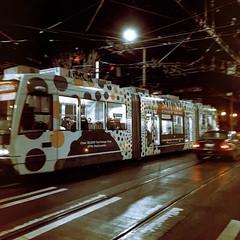 Movie Night (Blinking Charlie) Tags: hipstamatic331 iphonese broadway capitolhill firsthillstreetcar tram inekontrio night wetpavement street blinkingcharlie