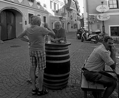 One for the road! Durnstein after work, chat around the barrel (brynjarviggos) Tags: life people men beer austria pub break wine bricks barrel streetlife durnstein onefortheroad