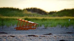 Knocked down. (jenniferlynnfowler) Tags: contrast outoffocus fallen hamptonbeach lateafternoon lifeguardchair tiltshift knockedover knockeddown