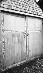 Garage Door (Man with Red Eyes) Tags: door monochrome analog blackwhite garage hc110 rangefinder lancaster peelingpaint iv locked yellowfilter leicam2 planetearth 160 adox silverhalide sunnysixteen summicron35mmf2 11mins v850 silvermax