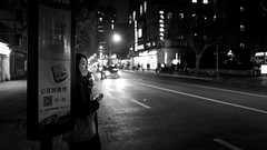 bus stop (Rob-Shanghai) Tags: shanghai night mono busstop bus girl people waiting china leica leicaq dark