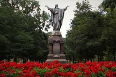 Venite Ad Me Omnes (michael.veltman) Tags: und university of notre dame red flowers statue south bend indiana venite ad me omnes come unto all ye