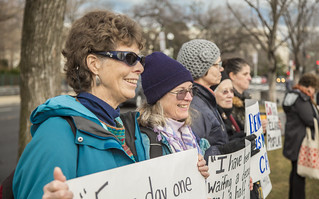 Protesters Holds Signs Outside the Ziglar v. Abbasi Hearing at the U.S. Supreme Court