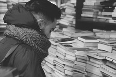 choose your book. (Nicole Favero) Tags: verde simone love cute cutie friend frindship awesome forever mine nikon nikond5000 shot eyes hair books color reflex photograph set venice cool awesomeness boy guy lesson chinese people bw blackandwhite black white lovely