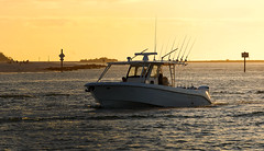 Lines Up for the Night (Poocher7) Tags: boat fishing fishermen fishingpoles rodsandreels oceanfishing shore water lagoon saltwater saltwaterfishing sunset evening dusk signs headingin fishingboat gulfofmexico sportfishing marcoisland florida usa southwestflorida waves ripples