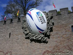 The giant rugby ball on the side of Cardiff Castle (southglosguytwo) Tags: city sky building tree artwork cardiff flags september cardiffcastle rugbyworldcup rugbyball 2015