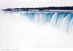 Water flowing over the Horseshoe Falls in Niagara Falls (Vincent Demers - vincentphoto.com) Tags: voyage longexposure trip travel ontario canada motion tourism nature water landscape outdoors niagarafalls waterfall eau niagara falls waterfalls northamerica paysage cascade extrieur chute touristattraction scenics mouvement tourisme horseshoefalls chutes niagarariver travelphotography travelphoto famousplace chutesniagara amriquedunord chutesdeau touristdestination traveldestination chutesduniagara photographiedevoyage attractiontouristique photodevoyage sitetouristique lieutouristique destinationtouristique travellocation destinationdevoyage rivireniagara