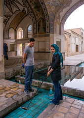couple taking a selfie in shotor galou-e-shah abbasi in fin garden, Isfahan Province, Kashan, Iran (Eric Lafforgue) Tags: travel people building tree tourism water fountain pool vertical architecture garden outdoors photography persian couple iran turquoise muslim islam middleeast landmark courtyard artificial pavilion stick shia iranian geography kashan 2people twopeople geographic islamicarchitecture selfie persiangulfstates fingarden watercanal cedartrees   16734 colourimage  iro isfahanprovince  baghefin westernasia  solomonspring bagdefin historicwalledgarden shotorgaloueshahabbasi thehsoleymaniehspring
