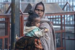 INDIA7446 (Glenn Losack, M.D.) Tags: street people india portraits photography delhi muslim islam poor mother photojournalism daughters buddhism impoverished flip flops local hindu scenics handicapped deformed beggars glennlosack losack glosack dahlits