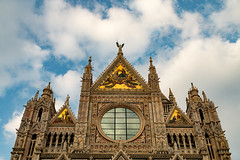 Duomo di Siena (PauloRossi) Tags: sky italy sculpture sun reflection tower art church architecture clouds mirror italia catholic cathedral columns sunny medieval tuscany siena duomo toscana