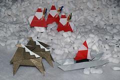 Santa-shaped pick holder (Yuko Fujimoto), Variation of the Santa -shaped chopstick wrapper (Katsuhisa Yamada), Sledge and Reindeer (Kunihiko Kasahara) (De Rode Olifant) Tags: santa christmas xmas weihnachten reindeer navidad origami december noel weihnachtsmann fatherchristmas santaclaus paperfolding noa kerstmis sledge kerst yamada fujimoto papanoel ruby3 kasahara kerstman kunihikokasahara origamisanta katsuhisayamada origamisantaclaus noamagazine marjansmeijsters yukofujimoto variationofthesantashapedchopstickwrapper santashapedchopstickwrapper noamagazine460 santashapedpickholder