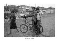 India Portrait - Varanasi (Vincent Karcher) Tags: asia india varanasi vincentkarcherphotography art beauty blackandwhite culture documentary human noiretblanc people portrait project reportage rue street travel voyage world kid children enfants bike bicycle