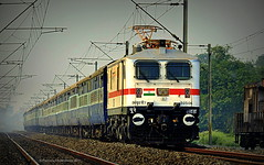 Indian Railways : Brand new WAP 7 in a hurry towing Shantiniketan Express towards destination, Howrah ! (Clicker Purnava) Tags: india indian railways indianrailways ir irfca iri incredible incredibleindia beauty beautiful travel traveller travelling travelphotography tour tourism 12338 bolpur shantiniketan bolpurshantiniketan howrah bhp hwh express indiatravel indialove train locomotive loco rail rails track road railroad railway bengal westbengal wb meb mirjapurbankipur superfast sf mps cruising transport amazing awesome passenger er easternrailway sunny sunnyday afternoon clw railfan railfanning railbuff trainsworldwide worldtrains ferroequinologist sky sport railwaylovers trainwatchers wap7 outstanding fantastic consist speed discoveryindia natgeo snowwhite vehicle outdoor