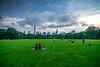 Romance in Central Park (dannygreyton) Tags: usa newyork centralpark clouds skyline sky skyscraper summer grass greatlawn people city urban