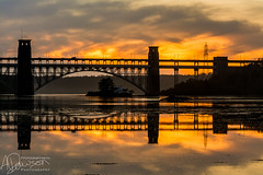 This Moment We Own (andrewjd44) Tags: wales warm sunset anglesey water reflections landscape britanniabridge bridge cymru northwales clouds