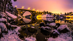 Eye of the Bridge (Jens Haggren) Tags: olympus em1 samyang75mm bridge winter sky water lights reflections snow nacka sweden jenshaggren