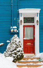 Red Door (Karen_Chappell) Tags: red door tree snow winter city house home urban canada nfld newfoundland eastcoast stjohns jellybeanrow downtown blue paint painted wood wooden clapboard january cold white