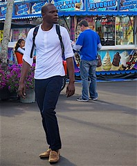 Young black man in white pullover (LarryJay99 ) Tags: dude arms attractivefolk urban dudes guys studly colors people white florida facialhair candid jeans man southfloridafair virile streets portrait city westpalmbeach blackpeople men handsome male blue stud face guy hotman blackman festival carnival urbanbackpacker 61305mm