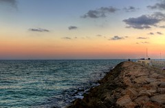 Sunset In Sitges (Crisp-13) Tags: sunset red sea sky sun rock set seaside spain waves groyne sitges hdr