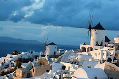 Windmills (Nagarjun) Tags: blue sunset sun white church island volcano evening europe glow santorini caldera oia cyclades mediterranian firostefani aegeansea