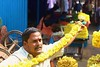 Spanning the length (bluelotus92) Tags: india flower market flowervendor karnataka mysore chrysanthemum flowerseller yellowchrysanthemum mysuru devarajursmarket devarajaursmarket spanningthelength