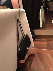 The handbag hanger is normal in these type of restaurants.