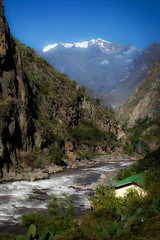 On the Train to Macchu Picchu (kate willmer) Tags: river mountain valley rapids house landscape peru