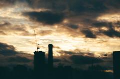 Moody Skies (Georgie_grrl) Tags: 7thanniversarywalk torontophotowalks social photographers friends toronto ontario topwa7 pentaxk1000 rikenon12828mm sky clouds moody sunset architecture crane silhouettes