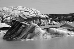 don't wake the sleeping ice maiden in her watery bed (lunaryuna) Tags: iceland southeasticeland svinafellsjokull glacier glacierlagoon glaciertongue glacialicefloes melting imagination shapes forms sleepingmaiden natureabstract blackwhite bw monochrome lunaryuna