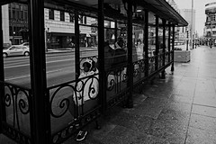 Bus Stop 1 (jswigal) Tags: city street people discreet bus stop traffic window black white blackandwhite sony a6000 rokinon 12mm candid columbus ohio person zz