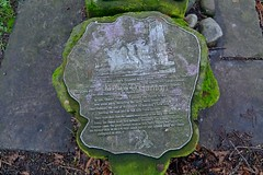 Information tile in garden area (James O'Hanlon) Tags: chester cheshire john baptist johnthebaptist church cathedral ruins norman medieval effigy stained glass chapel saint st