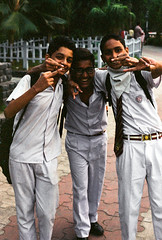 calcutta kids are number 1 (beau patrick coulon) Tags: 35mmfilm schoolboys calcutta kolkata india flippingoff middlefingers expiredfilm grainy