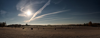 Vapour trails and hay bales