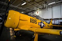 SNJ Texan (lncgriffin) Tags: california travel usa zeiss airplane nikon sandiego aircraft hangar usnavy warbird distagon ussmidway d610 snjtexan distagon2128zf